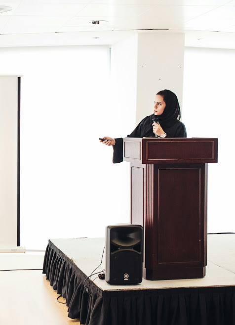 Hanady Alhashmi presenting to the staff at aldar properties